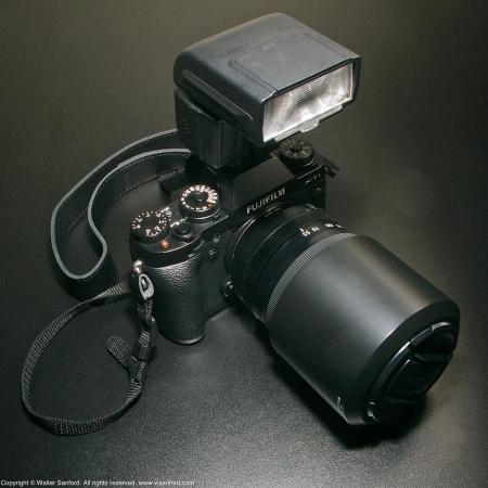 Fujifilm X-T1 mirrorless camera and Nissin i40 external flash unit.