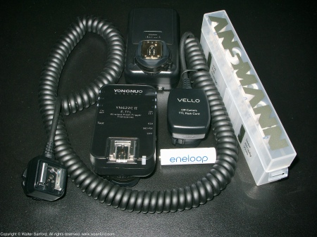 Accessories for external flash units: Ansmann battery case; Sanyo Eneloop rechargeable batteries; Vello Off-Camera TTL Flash Cord; Yongnuo YN622C II Wireless Flash Trigger Transceivers.