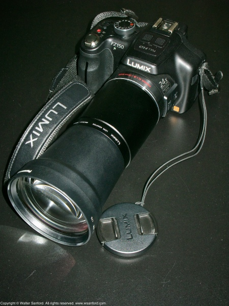 Panasonic Lumix DMC-FZ150 plus tele conversion lens (DMW-LT55) and lens adapter (DMW-LA5).