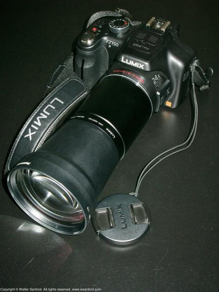 Panasonic Lumix DMC-FZ150 plus tele conversion lens (DMW-LT55) and lens adapter (DMW-LA5).