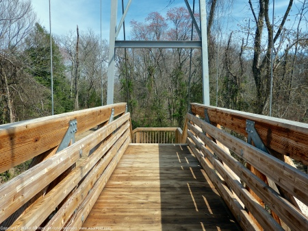 The new suspension bridge over Accotink Creek, Accotink Bay Wildlife Refuge, Fairfax County, Virginia USA.