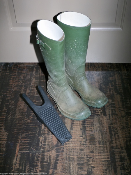 "A pair of L.L.Bean ""Green Wellies"" knee-high rubber boots and a JobSite Boot Puller (boot jack)."